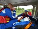 Над КАДом перестали летать вертолеты, спасающие пострадавших: Фоторепортаж
